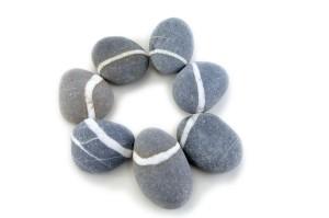 smooth stone on white background